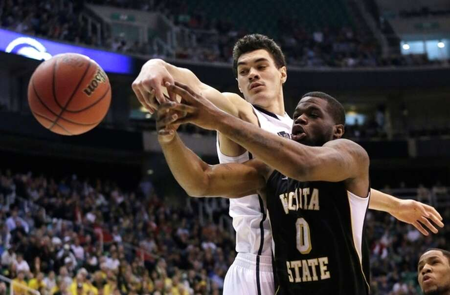 Wichita State's Chadrack Lufile (0) and Pittsburgh's Steven Adams (13) go after a rebound in the first half during a second round game in the NCAA college basketball tournament in Salt Lake City Thursday, March 21, 2013. (AP Photo/Rick Bowmer) / AP