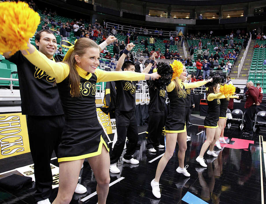 Wichita State cheerleaders preform before their game against Pittsburgh in a second-round game in the NCAA college basketball tournament in Salt Lake City Thursday, March 21, 2013. (AP Photo/George Frey) / FR10102 AP