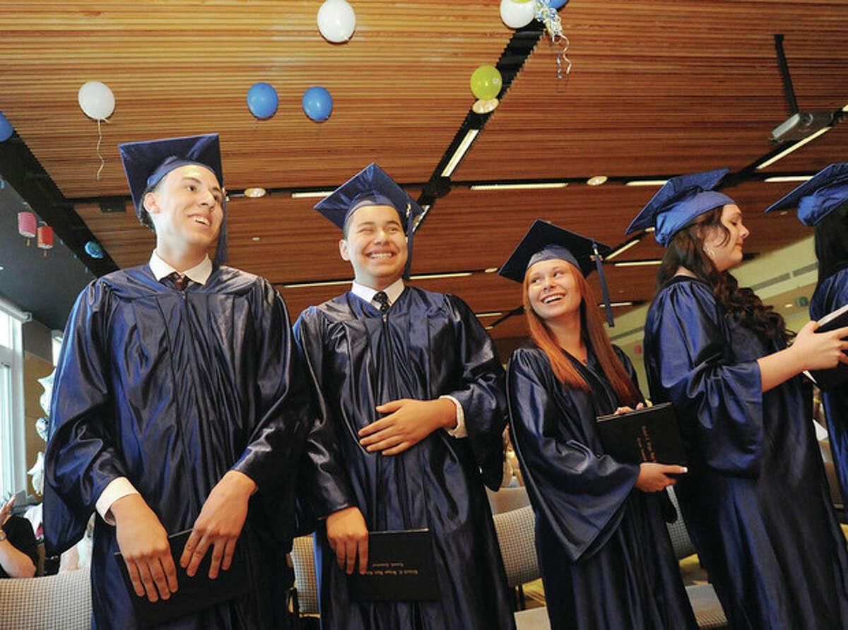 Hour photo / Matthew Vinci Angelo Duran, Jose Escobar, Ashley Klein and Erika Lahaie at the Briggs High School graduation Thursday in the Brien McMahon Center for Global Studies.