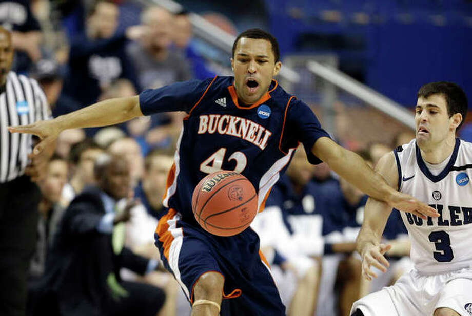 Bucknell guard Cameron Ayers (42) has the ball knocked away by Butler guard Alex Barlow (3) during the first half their second round NCAA college basketball tournament game Thursday, March 21, 2013, in Lexington, Ky. (AP Photo/John Bazemore) / AP