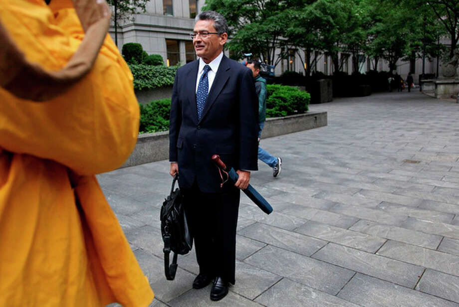 Rajat Gupta, former Goldman Sachs board member, pauses as he is photographed outside the Federal Courthouse in New York Monday, June 4, 2012. Gupta, on trial for a third week, is accused of passing secrets he learned from Goldman's board to a billionaire hedge fund founder who used the information to make millions of dollars. Gupta has pleaded not guilty. (AP Photo/Craig Ruttle) / FR61802 AP