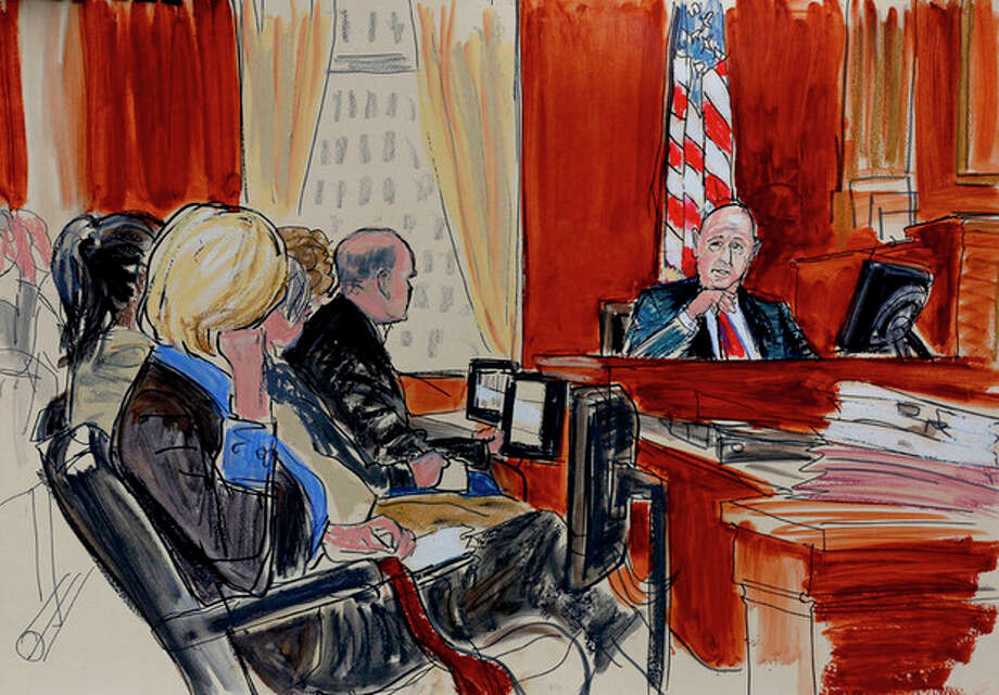 Goldman Sachs chief executive Lloyd Blankfein, right, is shown in this courtroom drawing playing with a rubber band while testifying Monday, June 4, 2012, at the Federal Courthouse in New York. For the second time in as many years, Blankfein was called by the government to testify as part of its case against former Goldman board member Rajat Gupta. Monday, June 4, 2012. (AP Photo/Elizabeth Williams) / FR 142054AP