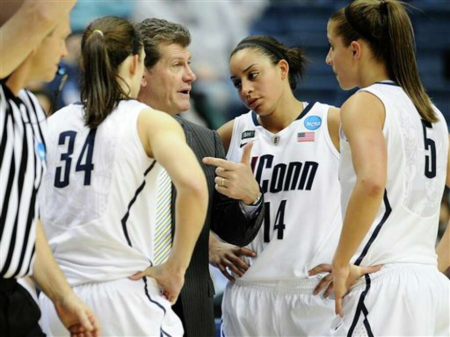 Connecticut head coach Geno Auriemma, second from left speaks with players Kelly Faris, left, Bria Hartley, second from right, and Caroline Doty, right, during the second half of a first-round game against Idaho in the women's NCAA college basketball tournament in Storrs, Conn., Saturday, March 23, 2013. Connecticut won 105-37. (AP Photo/Jessica Hill) / FR125654 AP