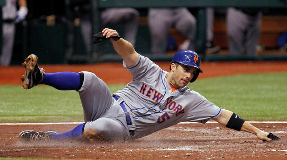 New York Mets' David Wright slides home safely on a third inning single by Ike Davis off Tampa Bay Rays starting pitcher Jeremy Hellickson during an interleague baseball game Thursday, June 14, 2012, in St. Petersburg, Fla. (AP Photo/Chris O'Meara) / AP