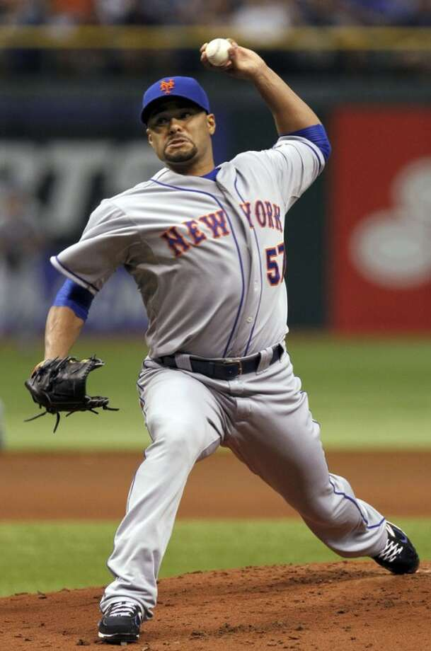 New York Mets starting pitcher Johan Santana delivers in the first inning of an interleague baseball game against the Tampa Bay Rays, Thursday, June 14, 2012, in St. Petersburg, Fla. (AP Photo/Chris O'Meara)