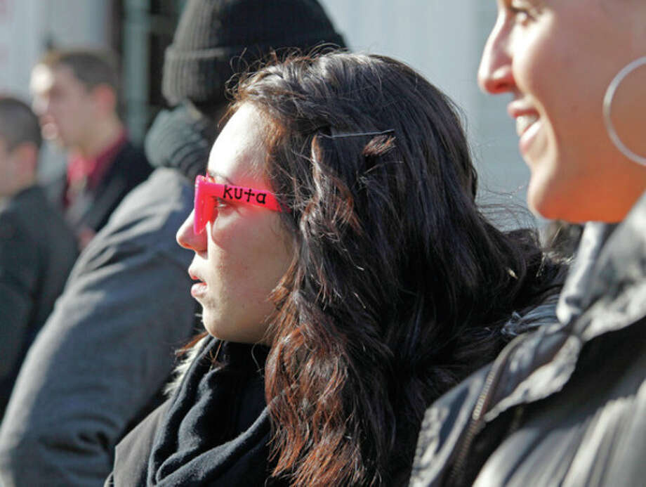 "A girl wears colorful sunglasses in honor of James ""Kuta"" Shaw at his funeral at the First Congregational Church on the Green in Norwalk Friday morning. Hour Photo / Danielle Robinson"