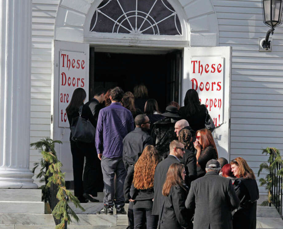 "Crowds wait to enter the funeral of James ""Kuta"" Shaw at the First Congregational Church on the Green in Norwalk Friday morning. Hour Photo / Danielle Robinson"