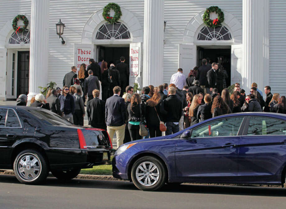 """Crowds wait to enter the funeral of James """"Kuta"""" Shaw at the First Congregational Church on the Green in Norwalk Friday morning. Hour Photo / Danielle Robinson"""