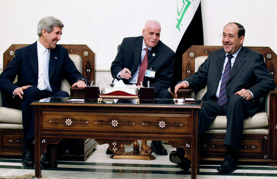 AP Photo/Jason Reed, PoolU.S. Secretary of State John Kerry, left, meets with Iraq's Prime Minister Nouri al-Maliki, right, in Baghdad, Iraq, Sunday, March 24. Kerry made an unannounced visit to Iraq on Sunday and will urge al-Maliki to make sure Iranian flights over Iraq do not carry arms and fighters to Syria, a U.S. official said. / Pool Reuters