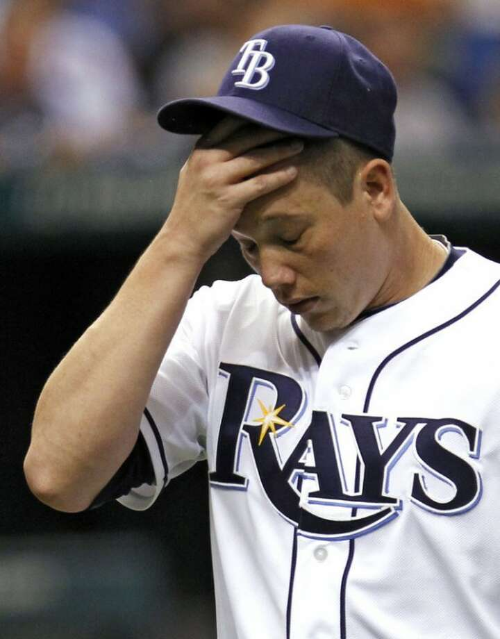 Tampa Bay Rays starting pitcher Jeremy Hellickson reacts as he leaves the mound after giving up three runs to the New York Mets during the second inning of an interleague baseball game Thursday, June 14, 2012, in St. Petersburg, Fla. (AP Photo/Chris O'Meara)