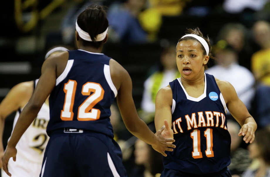 Tennessee Martin guard Heather Butler, right, reacts with teammate Jasmine Newsome, left, after making a three-point basket during the first half of a first-round game against Notre Dame in the women's NCAA college basketball tournament on Sunday, March 24, 2013, in Iowa City, Iowa. (AP Photo/Charlie Neibergall) / AP