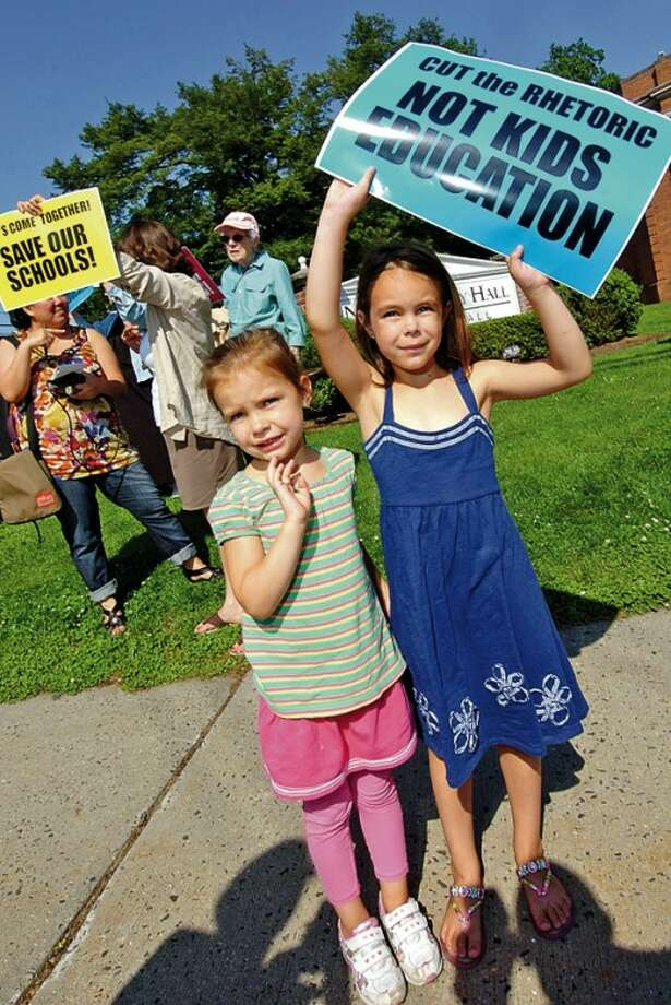 Protesters including Adeline and Ava Oustafine rally outside city hall addressing the budget shortfall ahead of the Common Council Finance / Claims Committee meeting Thursday. Hour photo / Erik Trautmann