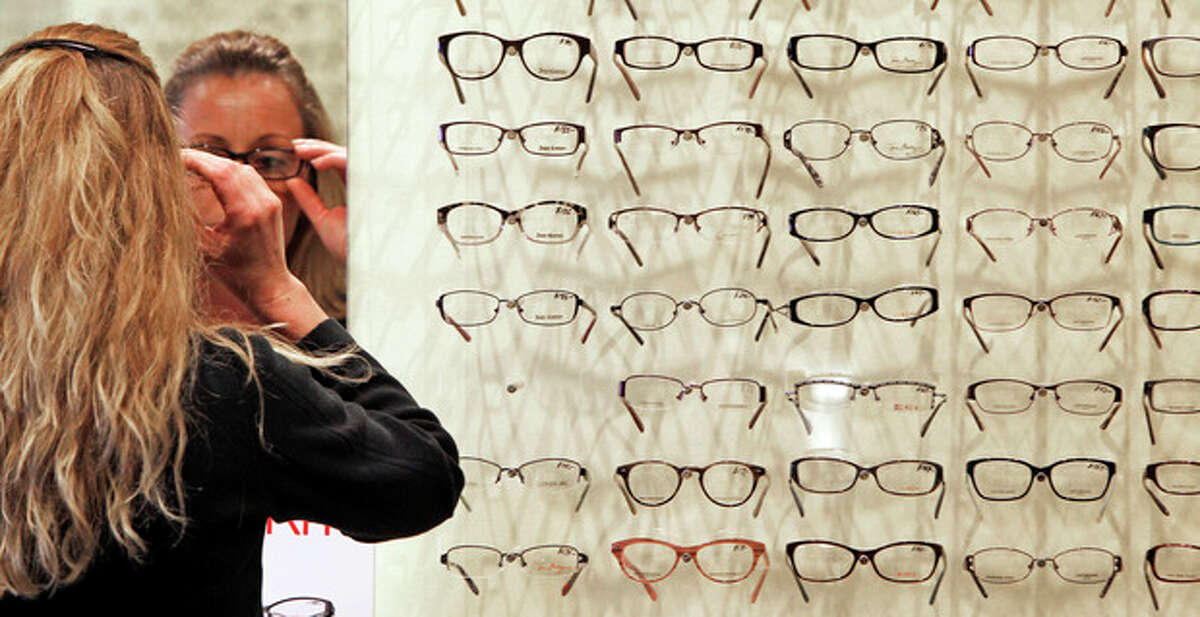 AP photo Sally Boyle tries on eyeglass frames at Berlin Optical Expressions at Berlin Optical Expressions in Berlin. The Labor Department said Thursday that the consumer price index dropped 0.3 percent in May.
