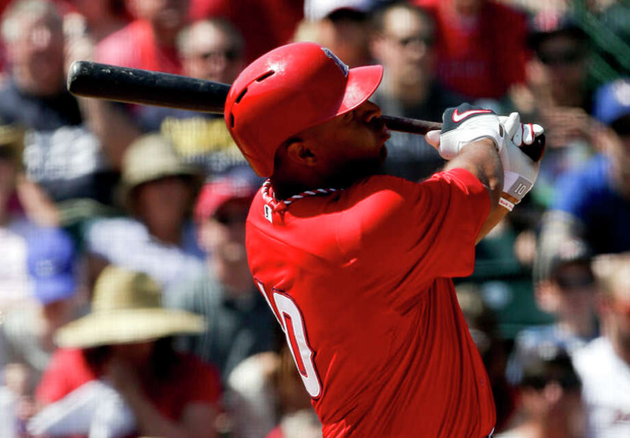 In this photo taken March 23, 2013, Los Angeles Angels' Vernon Wells bats against the Milwaukee Brewers during the third inning of a spring training baseball game in Tempe, Ariz. Wells might become the latest addition to the New York Yankees' injury-depleted lineup. (AP Photo/Chris Carlson) / AP