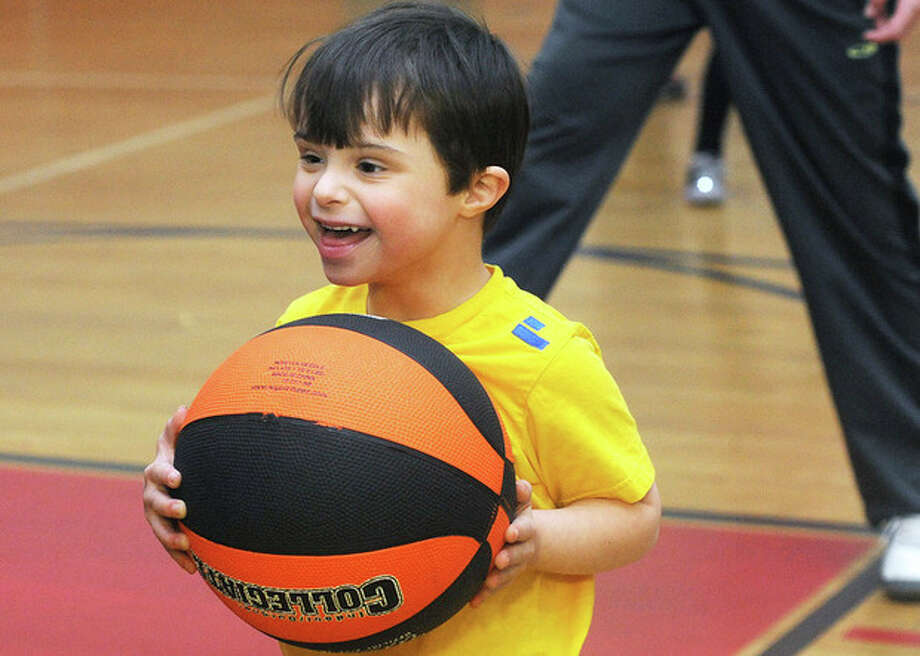 Hour photo / Matthew VinciJohn Vitale 6, enjoys the open basketball gym Sunday at the World Down Syndrome Day at the New Canaan YMCA.