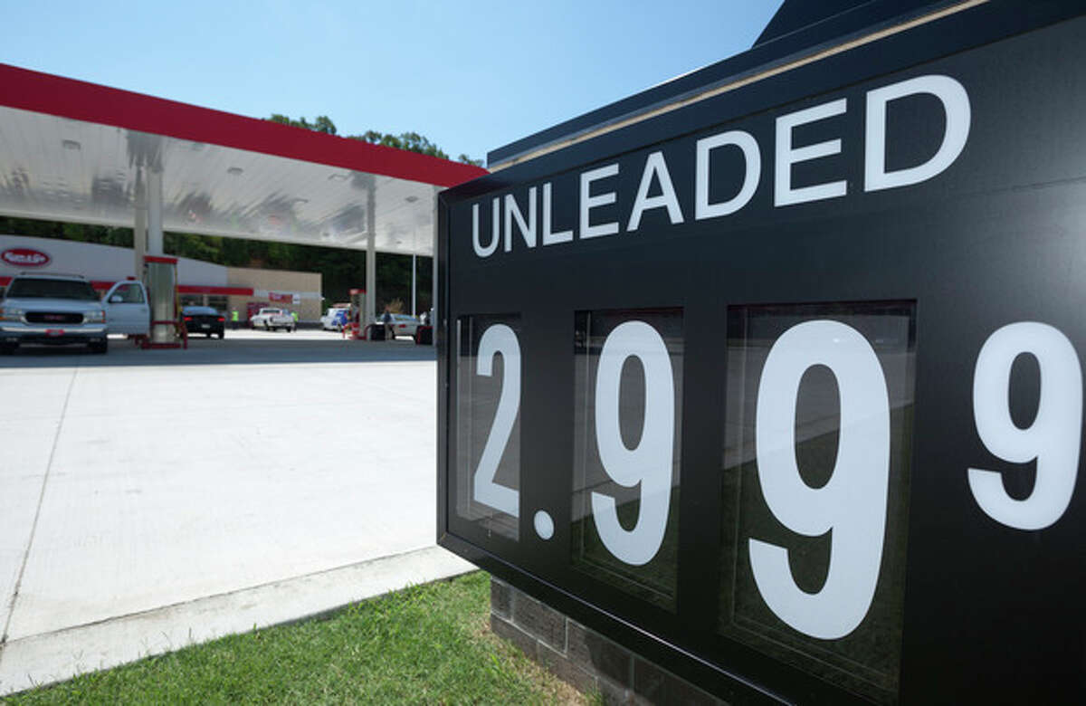 Motorists buy fuel at a gas station displaying a $2.99 price for regular unleaded gasoline in North Little Rock, Ark., Thursday, June 14, 2012. The Labor Department said Thursday that US Consumer prices fell in May by the most since December 2008, pulled down by a plunge in gas prices. (AP Photo/Danny Johnston)