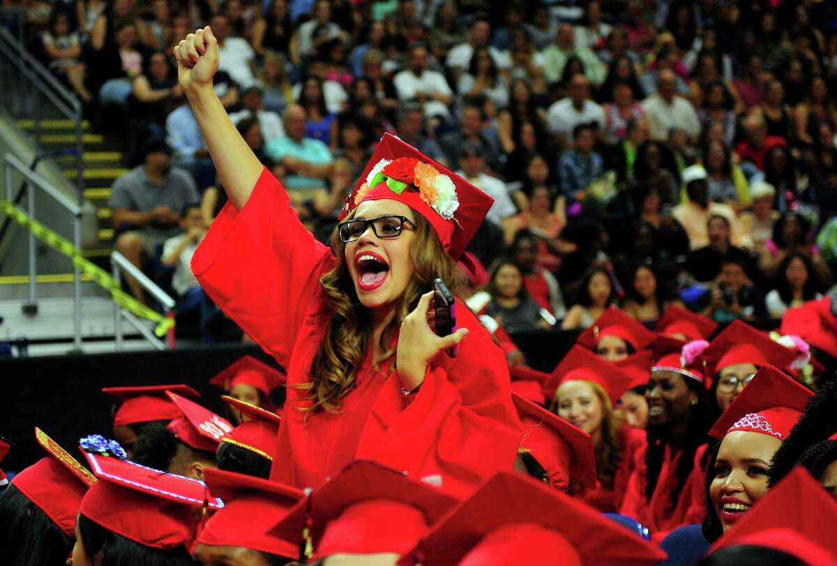 Graduate Kimberly Berrios cheers for a classmate during Central High School's Class of 2016 Graduation Exercises at the Webster Bank Arena in Bridgeport, Conn., on Tuesday June 14, 2016.