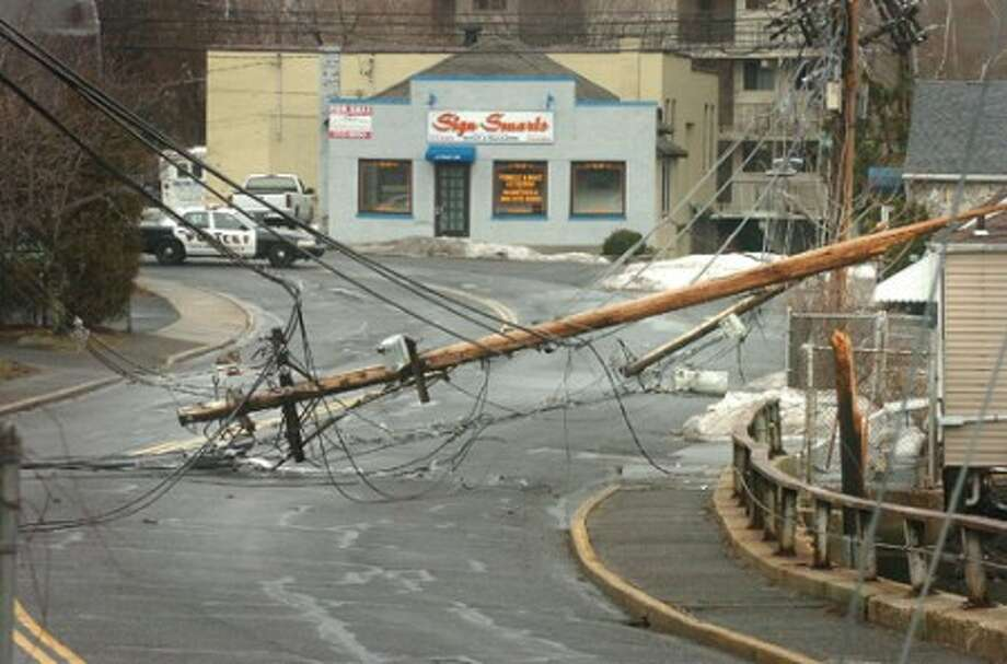 Photo/Alex von Kleydorff. Utility Poles down along a stretch of Seaview Ave in Norwalk and Osborne St causing road closures and power outages.