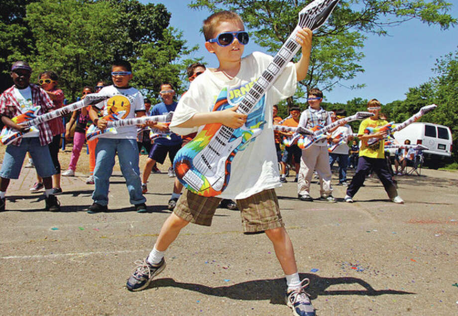 Third grader Dylan Consalati plays his air guitar through Good Enough as Wolfpit Elementary School holds it end of year celebration, Wolfpit Day Friday.Hour photo / Erik Trautmann / (C)2012, The Hour Newspapers, all rights reserved