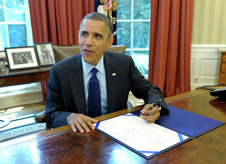 President Barack Obama talks in the Oval Office of the White House in Washington, Wednesday, June 3, 2012, prior to signing the Contract Awards for Large Air Tankers. The bill will support the ability to fight wildfires by enabling the Forest Service to accelerate the contracting of the next generation of air tankers for wildfire suppression. (AP Photo/Susan Walsh) / AP