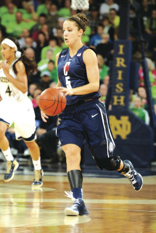Connecticut guard Caroline Doty heads up court during action in a college basketball game Monday March 4, 2013 in South Bend, Ind. (AP Photo/Joe Raymond)