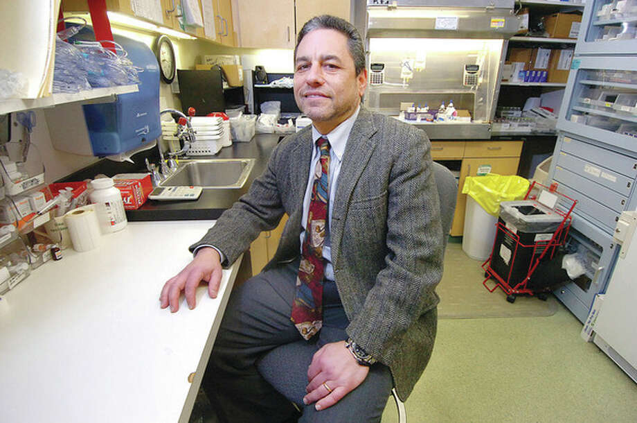 Hour photo / Alex von KleydorffDr. Richard Frank, medical oncologist and director of cancer research at Norwalk Hospital, is shown in the hospital's Whittingham Cancer Center pharmacy. / 2013 The Hour Newspapers