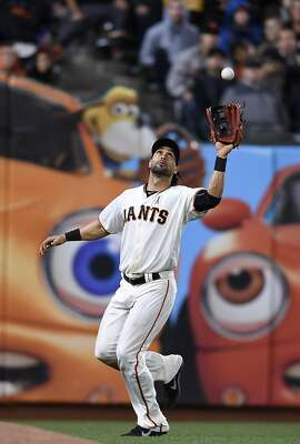 SAN FRANCISCO, CA - MAY 23:  Angel Pagan #16 of the San Francisco Giants catches a fly ball off the bat of Wil Myers #4 of the San Diego Padres in the top of the eighth inning at AT&T Park on May 23, 2016 in San Francisco, California.  (Photo by Thearon W. Henderson/Getty Images)