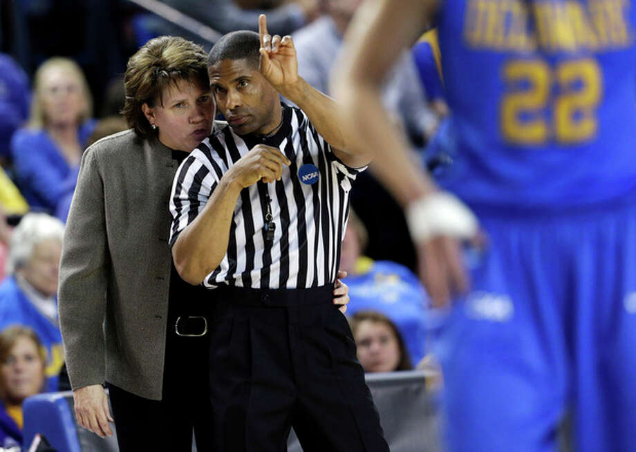 Delaware head coach Tina Martin, left, speaks with an official during a pause in play in the first half of a second-round game against North Carolina in the women's NCAA college basketball tournament in Newark, Del., Tuesday, March 26, 2013. (AP Photo/Patrick Semansky) / AP