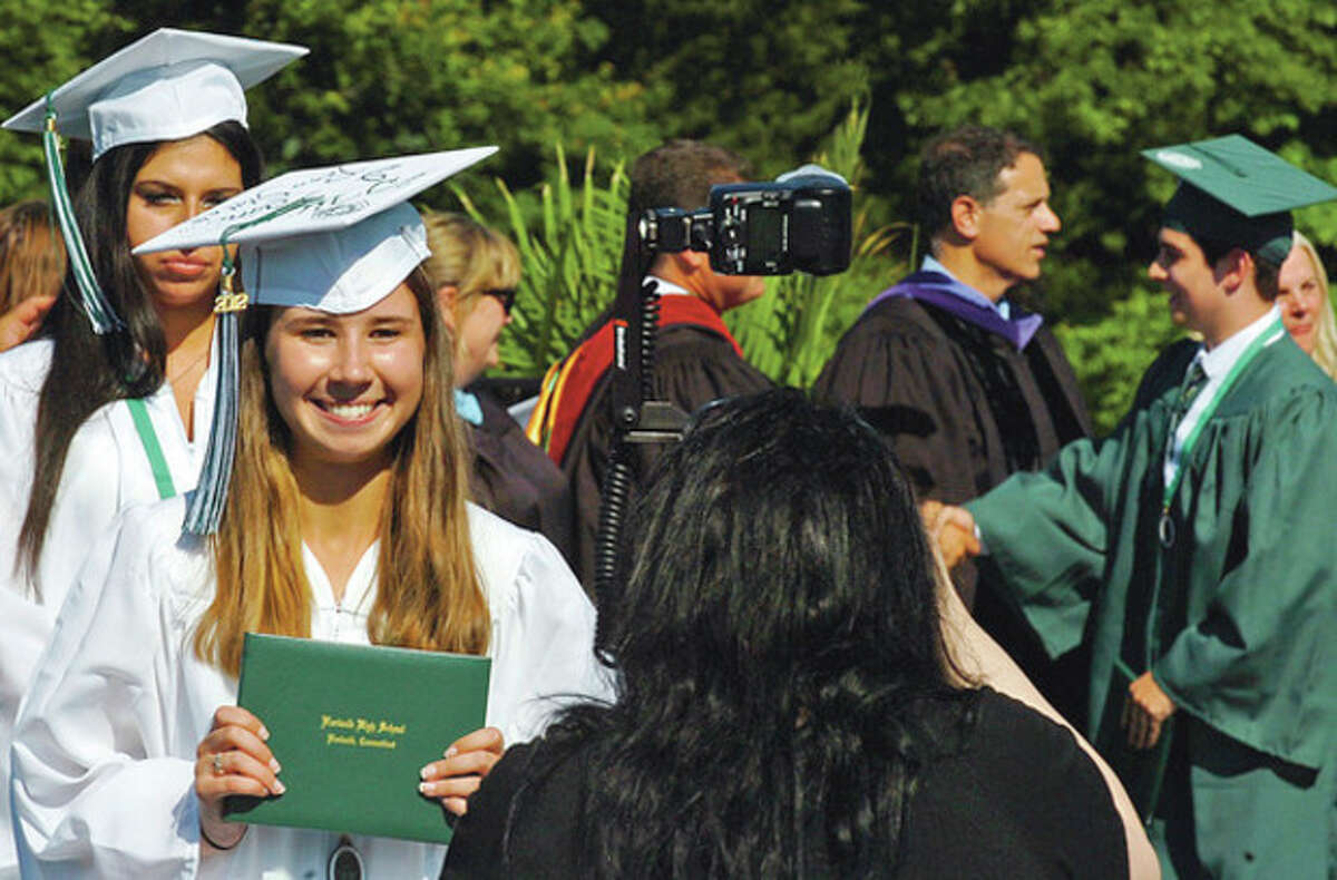 Norwalk High School graduate Montanna Casey poses for pictures during their commencement ceremonies Friday. Hour photo / Erik Trautmann