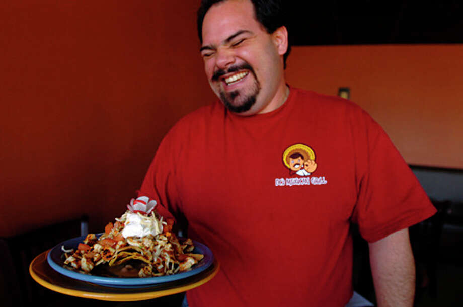 Hour photo / Erik TrautmannLuis Solis, owner of the new Don Carmelo's Mexican Grill & Tequila Bar at Winfield Street, was honored for his volunteerism. / (C)2011, The Hour Newspapers, all rights reserved