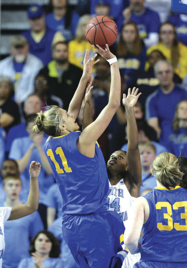 AP photoDelaware's Elena Delle Donne (11) shoots over North Carolina's Xylina McDaniel during the first half of Tuesday night's NCAA tournament second-round game. Delle Donne scored 33 points to lead the Blue Hens to a 78-69 victory that advanced them to the Sweet 16.