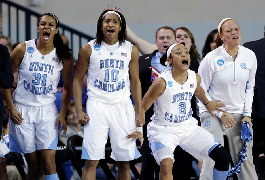 North Carolina's Erika Johnson, from left, Danielle Butts, Latifah Coleman and Whitney Adams react after guard Megan Buckland scored a 3-point basket during the first half of a second-round game against Delaware in the women's NCAA college basketball tournament in Newark, Del., Tuesday, March 26, 2013. (AP Photo/Patrick Semansky) / AP