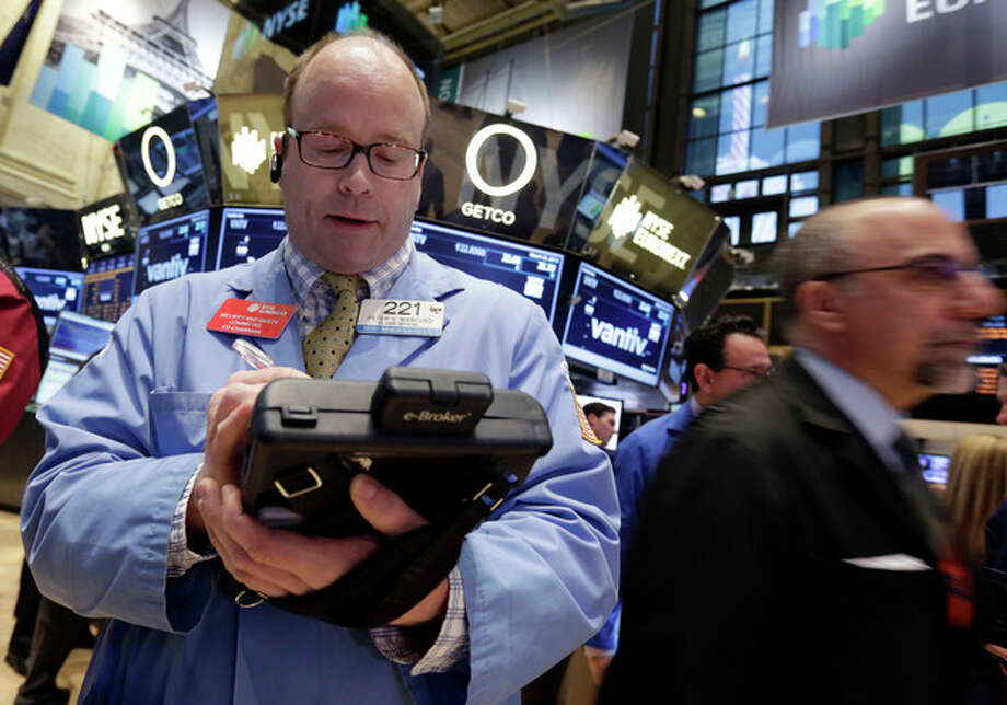 Trader Peter Mancuso, left, works on the floor of the New York Stock Exchange Monday, March 25, 2013. U.S. stock markets opened higher after Cyprus clinched a last-minute bailout that saved it from bankruptcy. (AP Photo/Richard Drew) / AP