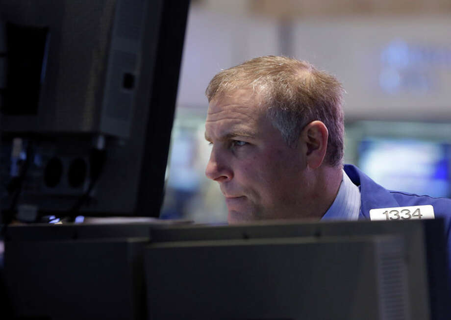 Specialist Geoffrey Friedman works on the floor of the New York Stock Exchange Monday, March 25, 2013. U.S. stock markets opened higher after Cyprus clinched a last-minute bailout that saved it from bankruptcy. (AP Photo/Richard Drew) / AP