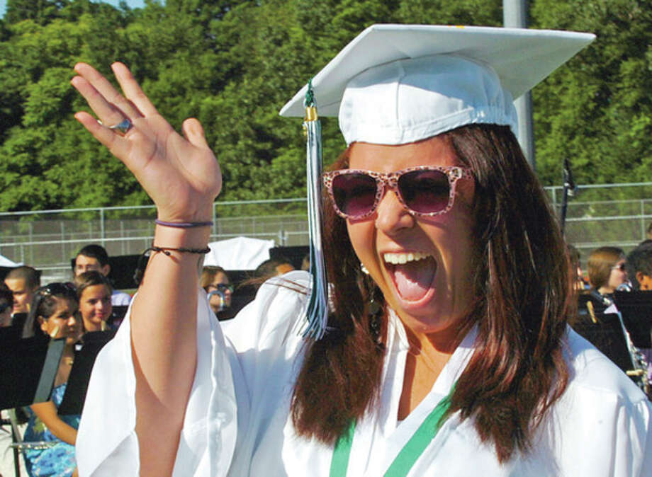 Norwalk High School graduate Annie DeJesus celebrates during their commencement ceremonies Friday.Hour photo / Erik Trautmann / (C)2012, The Hour Newspapers, all rights reserved
