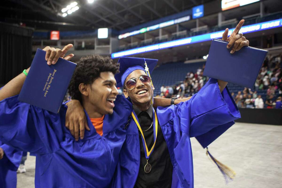 Jason Spencer and Donte Rodrigues celebrate as they leave the 90th Annual Commencement Ceremony for Warren Harding High School at Webster Bank Arena in Bridgeport, Conn. on Tuesday, June 14, 2016.