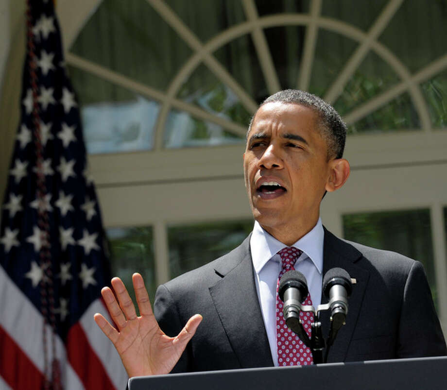 President Barack Obama announces that his administration will stop deporting and begin granting work permits to younger illegal immigrants who came to the U.S. as children and have since led law-abiding lives, Friday, June 15, 2012, during a statement in the Rose Garden of the White House in Washington. (AP Photo/Susan Walsh) / AP