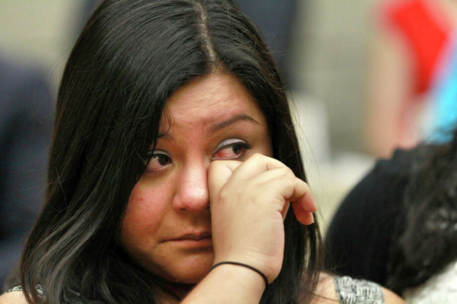 Myrna Orozco, 22, of Kansas City, Mo., an illegal immigrant originally from Mexico, wipes away tears while watching President Obama announce that the U.S. government will stop deporting and begin granting work permits to younger illegal immigrants who came to the U.S. as children and have since led law-abiding lives, Friday, June 15, 2102, in Washington. (AP Photo/Jacquelyn Martin) / AP