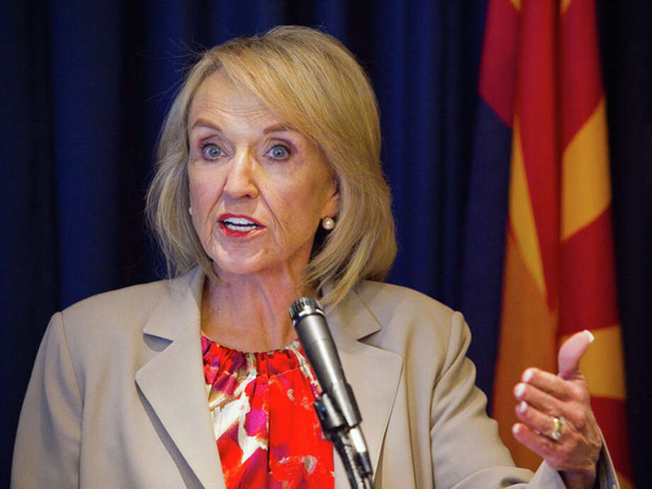 "Arizona Gov. Jan Brewer (R), responds to President Obama's immigration speech, Friday, June 15, 2012, at the Capitol in Phoenix. Brewer said President Barack Obama represents a ""pre-emptive strike"" aimed at an upcoming U.S. Supreme Court ruling that could uphold parts of the state's immigration enforcement law. (AP Photo/The Arizona Republic, Michael Schennum) MARICOPA COUNTY OUT; MAGS OUT; NO SALES / The Arizona Republic"