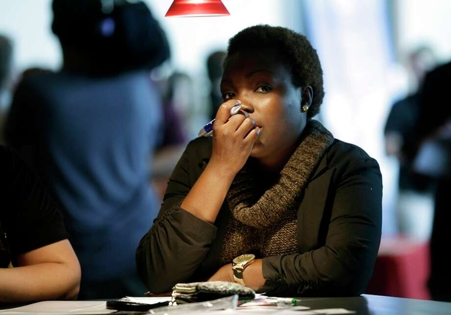 In this Tuesday, Jan. 22, 2013, photo, an unidentified woman pauses to think about her answer on a job application at the job fair in Sunrise, Fla. The number of Americans seeking unemployment benefits jumped by 16,000 for the week of ending March 23, 2013, the second straight weekly increase. But the longer-term trend in layoffs remained consistent with an improved job market. Applications increased to a seasonally adjusted 357,000 for the week ending March 23, the Labor Department said Thursday. That's up from 341,000 the previous week, which was revised slightly higher. (AP Photo/J Pat Carter) / AP
