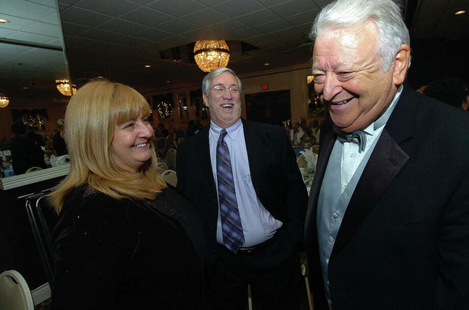 Mayor Richard Moccia shares a laugh with Rick and Alice McQuaid at The Mayors Community Ball. / 2011 The Hour Newspapers/ Alex von Kleydorff