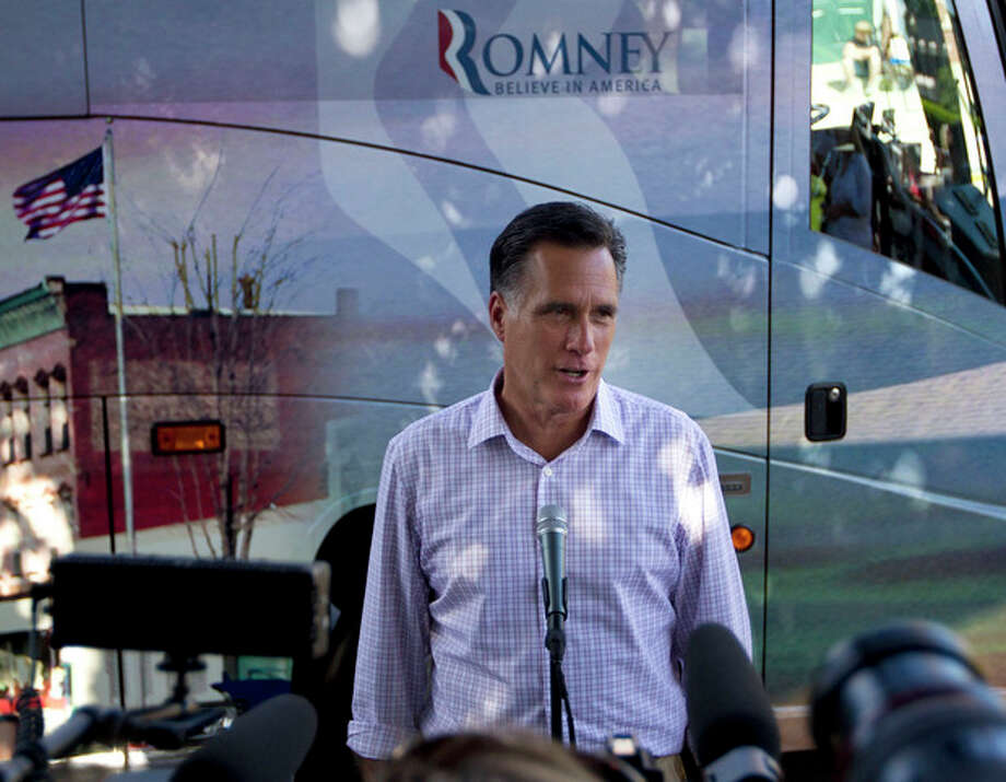 FILE - In this June 15, 2012 file photo, Republican presidential candidate, former Massachusetts Gov. Mitt Romney makes a statement on immigration, in Milford, N.H. There's not much President Barack Obama can do to boost the economy in the next five months, and that alone might cost him the November election. But on a range of social issues, Obama is bypassing Congress and aggressively using his executive powers to make it easier for gays to marry, women to obtain birth control, and, now, young illegal immigrants to avoid deportation. (AP Photo/Evan Vucci, File) / AP