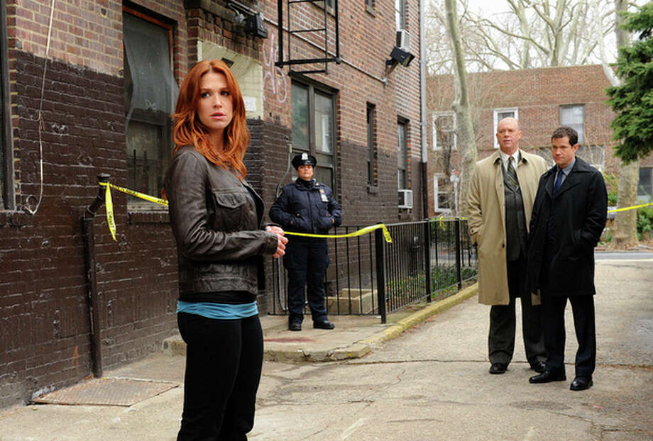 "AP photo / CBS, Barbara Nitke Poppy Montgomery is shown in a scene from ""Unforgettable,"" a drama about an enigmatic former detective with a rare condition that makes her able to recall every memory. The show premieres Sept. 20 on CBS. / ©2011 CBS Broadcasting Inc. All Rights Reserved"