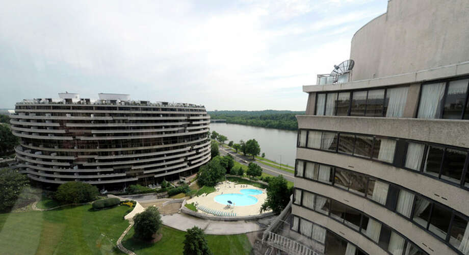 This photo taken May 30, 2012 shows a view of the Watergate complex from the top floor of the Watergate Office Building in Washington Forty years ago police in Washington arrested five men breaking in to the Democratic National Committee offices in Washington. The name of the complex they were breaking into became infamous: the Watergate. These days, though, unless you know where to look, there's little marking the location of the 1972 crime that ultimately led to the resignation of President Richard Nixon. The office building that was the site of the break in is still in use, though the tenants have changed. The adjacent hotel where the burglars stayed is currently closed. And another hotel across the street where a lookout waited with a walkie-talkie, monitoring the burglars' progress, has been turned into a college dorm. (AP Photo/Susan Walsh) / AP