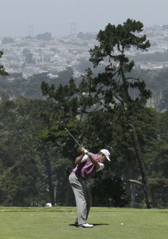 Lee Westwood, of England, hits a drive on the third hole during the third round of the U.S. Open Championship golf tournament Saturday, June 16, 2012, at The Olympic Club in San Francisco. (AP Photo/Eric Risberg)