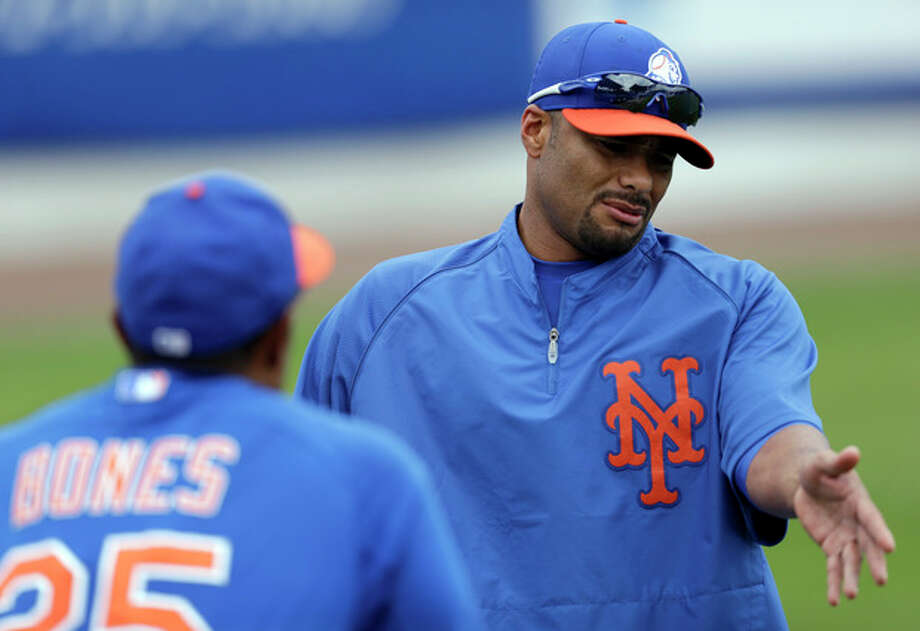 In this March 1, 2013, photo, New York Mets pitcher Johan Santana, right, talks to bullpen coach Ricky Bones (25) before the Mets' spring training baseball game against the Detroit Tigers in Port St. Lucie, Fla. The Mets say Santana has injured his left shoulder again and likely will need surgery and miss the 2013 season. (AP Photo/Julio Cortez) / AP