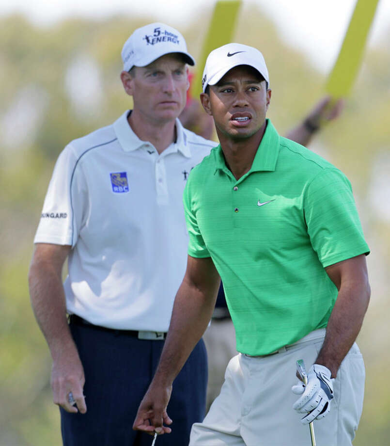 Jim Furyk and Tiger Woods are seen on the second tee during the third round of the U.S. Open Championship golf tournament Saturday, June 16, 2012, at The Olympic Club in San Francisco. (AP Photo/Eric Gay) / AP