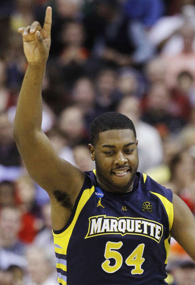 Marquette forward Davante Gardner (54) reacts to a score during the second half of an East Regional semifinal in the NCAA college basketball tournament against Miami, Thursday, March 28, 2013, in Washington. (AP Photo/Pablo Martinez Monsivais)