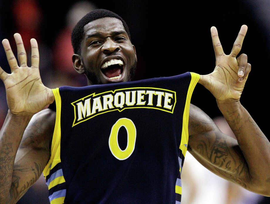 Marquette forward Jamil Wilson (0) celebrates their 71-61 win over Miami in an East Regional semifinal in the NCAA college basketball tournament, Thursday, March 28, 2013, in Washington. Wilson scored 16 points in the victory. (AP Photo/Mark Tenally) / AP
