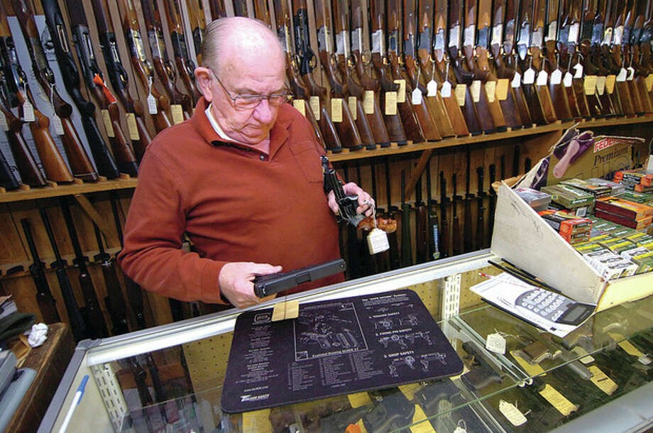 Hour photo / Alex von KleydorffBob Montlick in his store, Bob's Gun Exchange in Darien. / 2013 The Hour Newspapers